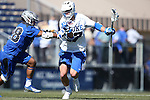 08 February 2015: Duke's Thomas Zenker (17) is defended by Air Force's Marcus Ward (28). The Duke University Blue Devils hosted the United States Air Force Academy Falcons at Koskinen Stadium in Durham, North Carolina in a 2015 NCAA Division I Men's Lacrosse match. Duke won the game 13-7.