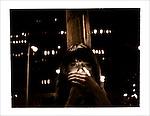 Sarah Slater lights a cigarette in a Denver parking lot.