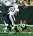 Green Bay Packers' Donald Driver loses his helmet after being hit by San Diego Chargers Marion McCree in the 1st quarter. McCree was called for Unnecessary Roughness giving the Packers a first down..The Green Bay Packers hosted the San Diego Chargers at Lambeau Field in Green Bay Sunday September 23, 2007. Steve Apps-State Journal.