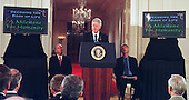 United States President Bill Clinton announces of the completion of the first survey of the entire Human Genome at the White House in Washington, DC on June 26, 2000. Doctor  J. Craig Venter, President and Chief Scientific Officer, Celera Genomics Corporation is seated at left and Doctor Francis Collins, Director, National Institutes of Health (NIH) is seated at right.<br /> Credit: Ron Sachs / CNP