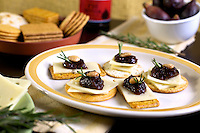 Italian Antipasti - crackers with cheese, fig spread and almonds