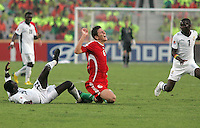 Hungary's  Zsolt Korcsmar (6) falls to the ground in pain after tangling withGhana's Mohammed Rabiu (13) during the FIFA Under 20 World Cup Semi-final match at the Cairo International Stadium in Cairo, Egypt, on October 13, 2009. Costa Rica won the match 1-2 in overtime play. Ghana won the match 3-2.