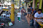 Christina Ong walks with her 9-year old daughter Gabriel through the Malate neighborhood of Manila, the capital city of the Philippines. Gabriel has Down Syndrome, and she and her mother participate in Kaisaka, a mothers' group that assists families which have members with disabilities.