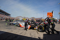 Apr 11, 2015; Las Vegas, NV, USA; Crew members push NHRA top fuel driver Clay Millican up to the burnout box during qualifying for the Summitracing.com Nationals at The Strip at Las Vegas Motor Speedway. Mandatory Credit: Mark J. Rebilas-