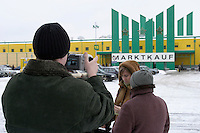Moscow, Russia, 02/01/2004..Customers at the Martkauf shopping mall wait for private bus service for shoppers.