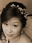 Taiwanese Wedding -- Bride glancing at the photographer.