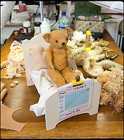 BNPS.co.uk (01202 558833)<br /> Pic: PhilYeomans/BNPS<br /> <br /> Each patient gets its own bed whilst awaiting their treatments.<br /> <br /> Broken bears and deteriorating dolls from all over the world are being brought back to life by a UK team of dedicated doctors and nurses at one of the last remaining toy hospitals.<br /> <br /> The team at Alice's Bear Shop, a teddy bear and doll hospital in Lyme Regis, Dorset, perform all kinds of 'surgery' from simple restringing and re-stuffing to head re-attachments and complete skin grafts.<br /> <br /> Rikey Austin, 49, opened the hospital in January 2000 but also ran a shop and only repaired one or two toys a month.<br /> <br /> Now she has a four-month waiting list for patients and has had to close the shop to focus on the hospital side of the business.