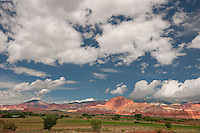 731350256 clouds over the waterpocket fold at the west entrance to capitol reef national park utah united states