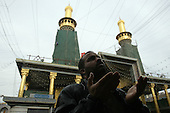 KARBALA, IRAQ: A Shia pilgrim looks skyward while he prays...Shia pilgrims pray during the last day of the Ashura festival...Photo by Metrography