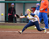 Michigan Wolverines infielder Caitlin Blanchard (44) stretches for a throw during the season opener against the Florida Gators on February 8, 2014 at the USF Softball Stadium in Tampa, Florida.  Florida defeated Michigan 9-4 in extra innings.  (Copyright Mike Janes Photography)
