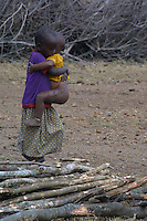 This young Maasai girl is kept from getting an education in order to care for her siblings while her mother searches for water or firewood. Young tribal Kenya girls are not valued for more than cooking, cleaning, child rearing, and marriage. By age nine, many Maasai girls are taken for Female Genital Mutilation, and sold for marriage for as few as five to ten cows.