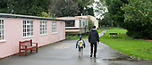Father and daughter arriving for the day, Summerhill School, Leiston, Suffolk. The school was founded by A.S.Neill in 1921 and is run on democratic lines with each person, adult or child, having an equal say.  You don't have to go to lessons if you don't want to but could play all day.  It gets above average GCSE exam results.