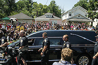 LOUISVILLE, KY - JUNE 10: The motorcade Muhammad Ali drives along in the funeral procession motorcade on Grand Avenue in front of Ali's childhood home in on June 10, 2016 in Louisville, Kentucky. (Photo by VIEWpress/Teddy Blackburn)