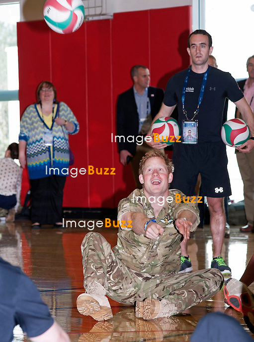 PRINCE HARRY.plays seating volleyball with members of his team during the Warrior Games in Colorado Springs, Olympic Park_11/05/2013.Prince Harry is on a week long USA visit the includes Washington, Denver, Colorado Springs, New Jersey, New York and Conneticut..Prince Harry is on a week long USA visit the includes Washington, Denver, Colorado Springs, New Jersey, New York and Conneticut.