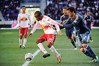 Dane Richards (19) of the New York Red Bulls is defended by Todd Dunivant (2) of the Los Angeles Galaxy during the 1st leg of the Major League Soccer (MLS) Western Conference Semifinals at Red Bull Arena in Harrison, NJ, on October 30, 2011.