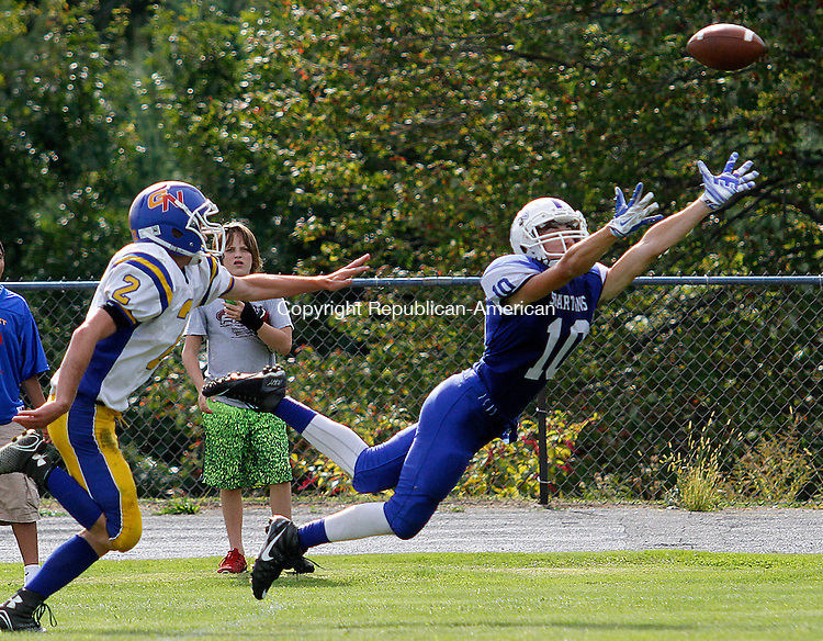 BURLINGTON, CT - 26 SEPTEMBER 2015 - 092615JW01.jpg -- Lewis  Mills #10 Mathew Rinkus tries to grab for a pass while Gilbert #2 Ben Schiffer tries to catch him at Lewis S. Mills Saturday afternoon. Jonathan Wilcox Republican-American