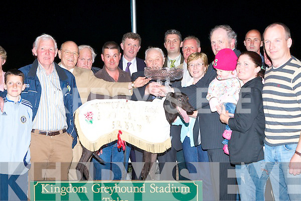 TOP DOG: Owner of the winner of the Lee Strand Paddy O'Sullivan Spring Twilight Race Of Champions Pat Collins being presented with trophy by Mike Moyihan and Bill Kenndey CEO of Lee Strand at the Lee Strand evening of racing at the Kingdom Greyhound Stadium on Friday night l-r: Padraig, Paddy and Abbie Collins, Keiran O'Dwyer, Mike Moyihan (Lee Strand), Bill Kennedy (CEO), Noreen and Cathrine Collins, Brendan Walsh and Donnie Mulivhill.