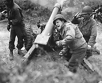 American howitzers shell German forces retreating near Carentan, France.  July 11, 1944.  Franklin.  (Army)<br /> NARA FILE #:  111-SC-191933<br /> WAR &amp; CONFLICT BOOK #:  1047