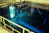 Fuel rod storage pool in a nuclear power plant showing the blue glow of the Cherenkov effect.