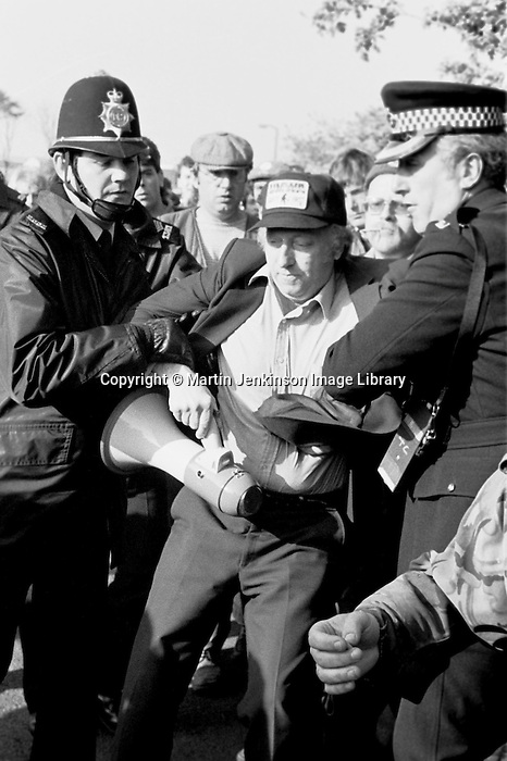 Superintendent John Nesbit arrests Arthur Scargill, NUM President at Orgreave during the 1984-85 miners strike...© Martin Jenkinson tel 0114 258 6808  mobile 07831 189363 email martin@pressphotos.co.uk  NUJ recommended terms & conditions apply. Copyright Designs & Patents Act 1988. Moral rights asserted credit required. No part of this photo to be stored, reproduced, manipulated or transmitted by any means without prior written permission.