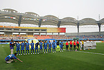 06 August 2008: The starting lineups of Japan (in blue) and New Zealand (in white) before the game.  The women's Olympic team of New Zealand tied the women's Olympic soccer team of Japan 2-2 at Qinhuangdao Olympic Center Stadium in Qinhuangdao, China in a Group G round-robin match in the Women's Olympic Football competition.