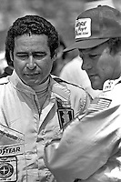 INDIANAPOLIS, IN - MAY 28: Danny Ongais (left) and AJ Foyt (right) converse in the pit lane during practice for the Indy 500 at the Indianapolis Motor Speedway in Indianapolis, Indiana, on May 28, 1978.