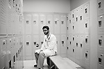Dr. Jawad Ali, a third year resident, sits in the locker room at University Medical Center Brackenridge. November 27, 2012