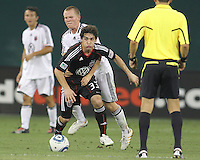 Martin Rivas #33 of D.C. United breaks away from Matthew Ritchie #3 of Portsmouth FC during an international friendly match at RFK Stadium on July 24 2010, in Washington D.C.United won 4-0.