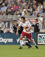 New York Red Bulls midfielder Sinisa Ubiparipovic (8) moves the ball as New England Revolution defender Seth Sinovic (27) pressures. The New England Revolution defeated the New York Red Bulls, 3-2, at Gillette Stadium on May 29, 2010.