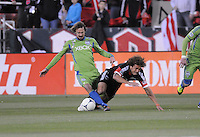 D.C. United midfielder Nick DeLeon (18) gets tackle by Seattle Sounders midfielder Roger Levesque (24)  D.C. United tied The Seattle Sounders 0-0 at RFK Stadium, Saturday April 7, 2012.