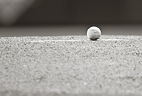 Detail shot of baseball on pitcher's mound pre-game. Seattle Mariners at Texas Rangers. Phootgraphed at Rangers Ballpark In Arlington in Arlington, Teas on Saturday, April 10, 2010. Photograph &copy; 2010 Darren Carroll.