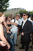 "Tom Cruise, narrator of the new film ""Imax Space Station 3D"", poses with an unidentified fan as he arrives at the National Air and Space Museum for the premiere of the movie in Washington, D.C. on April 17, 2002..Credit: Ron Sachs / CNP"