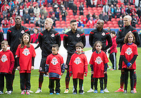 Toronto, Ontario - May 3, 2014: Toronto FC players stand for the national anthems during the opening ceremonies in a game between the New England Revolution and Toronto FC at BMO Field.<br /> The New England Revolution won 2-1.