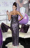 Amy Childs.The photocall to launch her debut fragrance in collaboration with Jigsaw, Aura bar & nightclub, London, England..August 15th, 2012.full length purple strapless dress  sequins sequined hair up bun hand on hip looking down.CAP/CAN.©Can Nguyen/Capital Pictures.