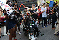Demonstrators march from Federal Plaza to support a Citizens Police Accountability Council to provide civilian oversight of the Chicago Police Department in Chicago, Illinois on July 11, 2016.  The demonstration attracted a larger crowd on the heels of last week's racially charged police shootings captured on video of Alton Sterling in Baton Rouge, Louisiana and Philando Castile in the St. Paul suburb of Falcon Heights, Minnesota which was followed by a mass shooting of five police officers by Afghan War veteran Micah Johnson who supported radical and violent black nationalist ideology.