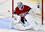 31 March 2010: Montreal Canadiens' goaltender Carey Price makes a first period blocker save against the Carolina Hurricanes at the Bell Centre in Montreal, Quebec, Canada. The Hurricanes defeated the Canadiens 2-1. Mandatory Credit: Ed Wolfstein Photo