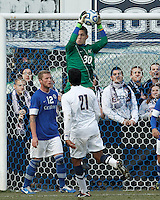 Creighton University goalkeeper Jeff Gal (30) collects a cross..NCAA Tournament. Creighton University (blue) defeated University of Connecticut (white), 1-0, at Morrone Stadium at University of Connecticut on December 2, 2012.
