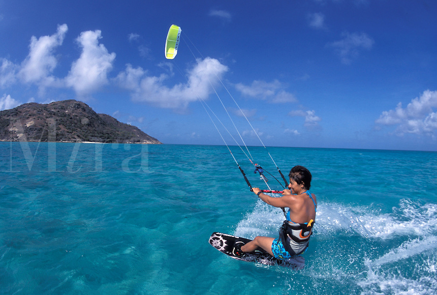 Australia, Qld., Great Barrier Reef, woman kitesurfing.  MR available