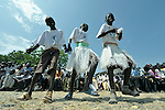Youth dance during an outdoor Mass in Christ the King Catholic parish in Malakal, Southern Sudan, on November 21, 2010.