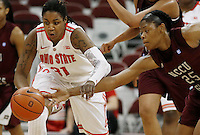 North Carolina's Tisha Dixon (25) tries to knock the ball away from Ohio State's Raven Ferguson (31) during a women's basketball game between the Ohio State Buckeyes and the North Carolina Central Eagles on December 29, 2013 at Value City Arena. (Columbus Dispatch photo by Fred Squillante)