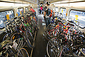 Caltrain's bike car becomes packed with bicycles during the afternoon commute. Northbound Caltrain train, Mountain View, California, USA
