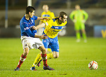 Cowdenbeath v St Johnstone ..17.12.12      Scottish Cup.Craig Beattie fends off Lewis Milne.Picture by Graeme Hart..Copyright Perthshire Picture Agency.Tel: 01738 623350  Mobile: 07990 594431
