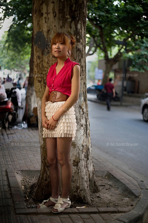 Zhangzhengya, an independent clothing seller, age 24, poses for a portrait in Nanjing. Response to 'What does China mean to you?': 'To me the word China is like a mother. It provides for you. Doesn't ask you to give anything back. We are proud to have a &quot;mother&quot; like this. Self-pride.'  Response to 'What is your role in China's future?': 'We should believe that we will grasp our role in the future. Work hard. Generously think of ways to support our country.'