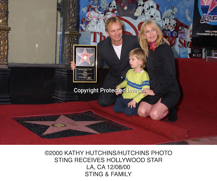 ©2000 KATHY HUTCHINS/HUTCHINS PHOTO.STING RECEIVES HOLLYWOOD STAR.LA, CA 12/08/00.STING & FAMILY