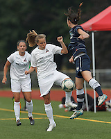 Boston Aztec forward Tori McCombs (5) attempts to control the ball. In a Women's Premier Soccer League (WPSL) match, Boston Aztec (white) defeated Seacoast United Phantoms (blue), 3-0, at North Reading High School Stadium on Arthur J. Kenney Athletic Field on on June 25, 2013.