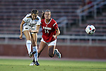 22 September 2016: Notre Dame's Kaleigh Olmstead (27) shoots past NC State's Taylor Porter (14). The North Carolina State University Wolfpack hosted the University of Notre Dame Fighting Irish at Dail Soccer Field in Raleigh, North Carolina in a 2016 NCAA Division I Women's Soccer match. Notre Dame won the game 1-0.