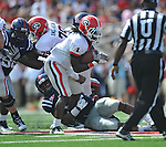 Georgia running back Isaiah Crowell (1) is tackled by Ole Miss' Mike Marry (52) at Vaught-Hemingway Stadium in Oxford, Miss. on Saturday, September 24, 2011. Georgia won 27-13.
