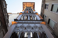 The Elevador de Santa Justa or Santa Justa lift, connecting the lower streets in Baixa with the higher Carmo Square, designed by Raoul Mesnier du Ponsard and inaugurated 1901, Santa Justa, Lisbon, Portugal. The vertical lift is 45m high and is decorated in Neo-Gothic ironwork. Picture by Manuel Cohen