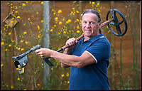 BNPS.co.uk (01202 558833)<br /> Pic: TomWren/BNPS<br /> <br /> Brian Biddle with his metal detector.<br /> <br /> A metal detectorist is celebrating today after a gold coin he unearthed in a farmer's field sold for more than &pound;50,000.<br /> <br /> Brian Biddle, 64, thought he had dug up an old bottle top before he swept off the mud to find it was an incredibly rare Angel coin struck during the reign of King Edward V in 1483.<br /> <br /> The relic had lain undisturbed in the field in Puddletown, Dorset, for more than 500 years until members of the Stour Valley Search and Recovery Club turned up.