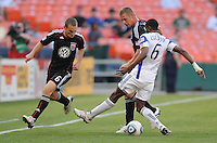 DC United forward Danny Allsopp (9) makes a pass to his team mate Kurt Morsink (6) while cover by Kansas City Wizards defender Pablo Escobar (6).  DC United defeated The Kansas City Wizards  2-0 at RFK Stadium, Wednesday  May 5, 2010.